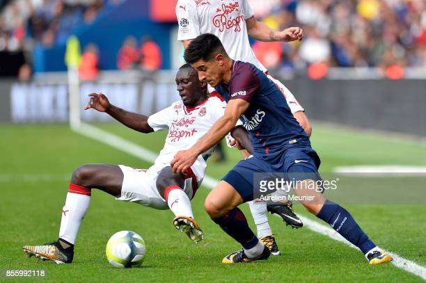 Yuri Berchiche of Paris SaintGermain fights for the ball during the Ligue 1 match between Paris Saint Germain and FC Girondins de Bordeaux at Parc...