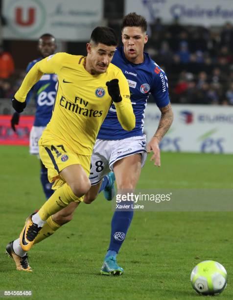 Yuri Berchiche of Paris SaintGermain in action with Jonas Martin of Strasbourg during the Ligue 1 match between Strasbourg and Paris Saint Germain at...