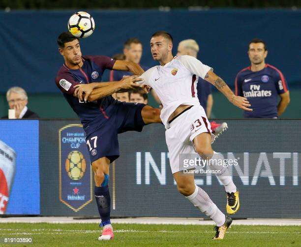 Yuri Berchiche of Paris SaintGermain tangles with Marco Tumminello of AS Roma while going after the ball during the second half at Comerica Park on...