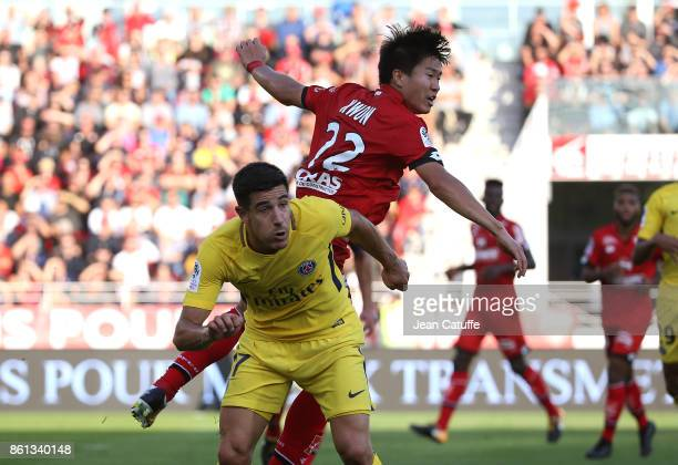 Yuri Berchiche of PSG Changhoon Kwon of Dijon during the French Ligue 1 match between Dijon FCO and Paris Saint Germain at Stade Gaston Gerard on...