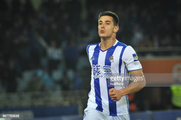 Yuri Berchiche of Real Sociedad celebrates with teammates after scoring during the Spanish league football match between Real Sociedad and Sporting...
