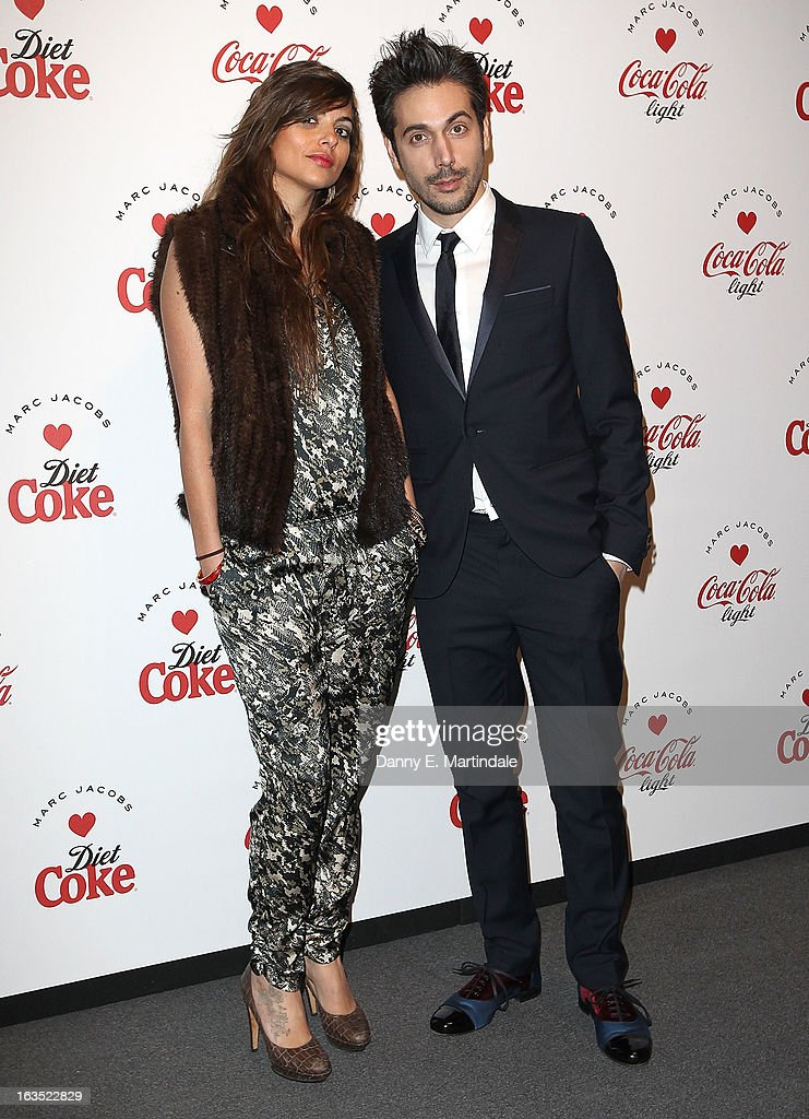 Yuri Buzzi (R) and friend attends the launch party announcing Marc Jacobs as the Creative Director for Diet Coke in 2013 on March 11, 2013 in London, England.