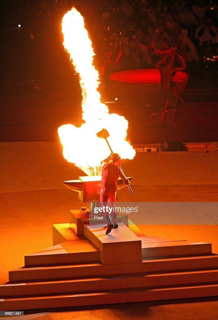 Yuri Chechi an Olympic gymnast from Italy starts the ceremony by pounding an anvil during the Opening Ceremony of the Turin 2006 Winter Olympic Games...