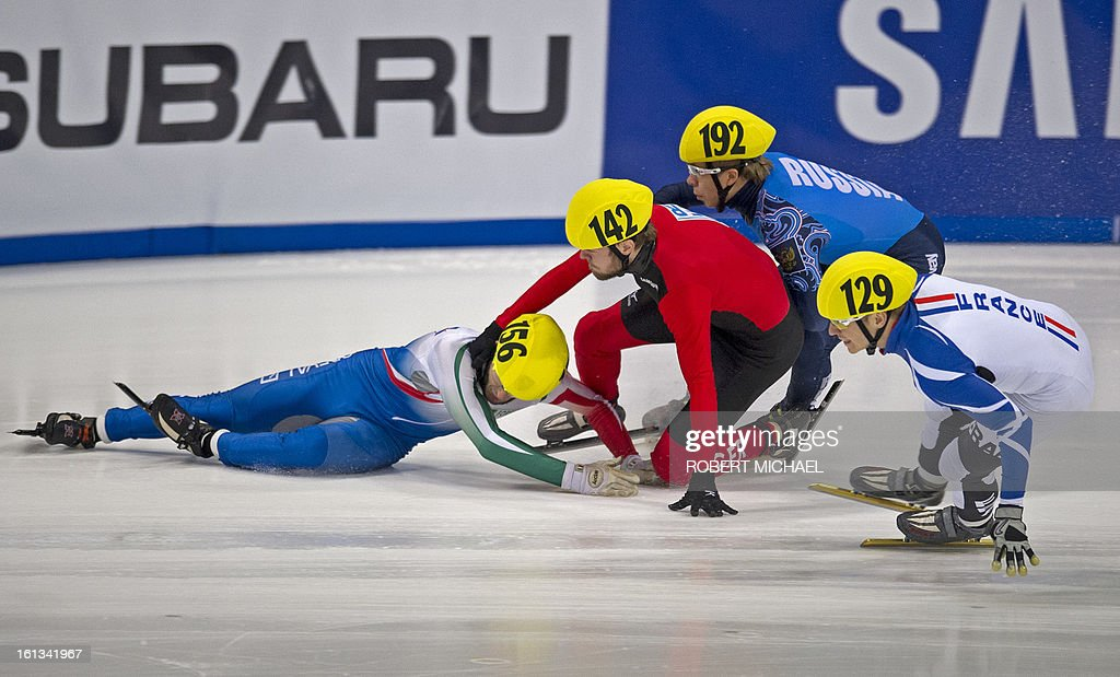 Yuri Confotola of Italy, Paul Herrmann of Germany, Semen Elistratov of Russia and Maxime Chataignier of France crash during the men's 1500m semi final race of the ISU World Cup short track speed skating event in Dresden, eastern Germany, on February 10, 2013.