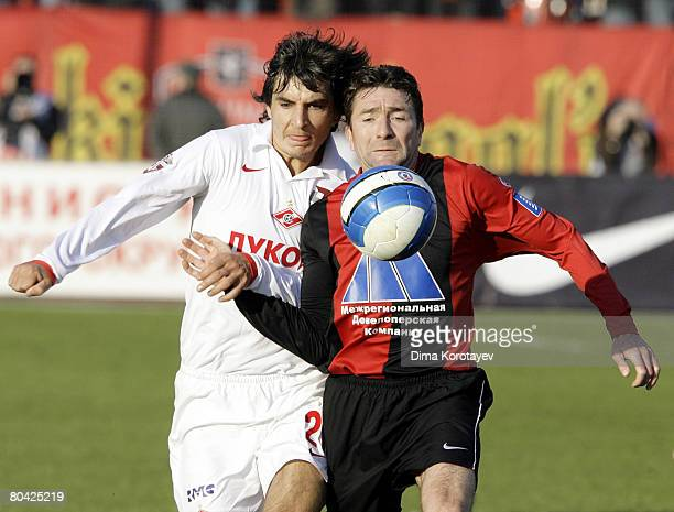 Yuri Drozdov of FC Khimki competes for the ball with Sergei Kovalchuk of FC Spartak during the Russian Football League Championship match between FC...