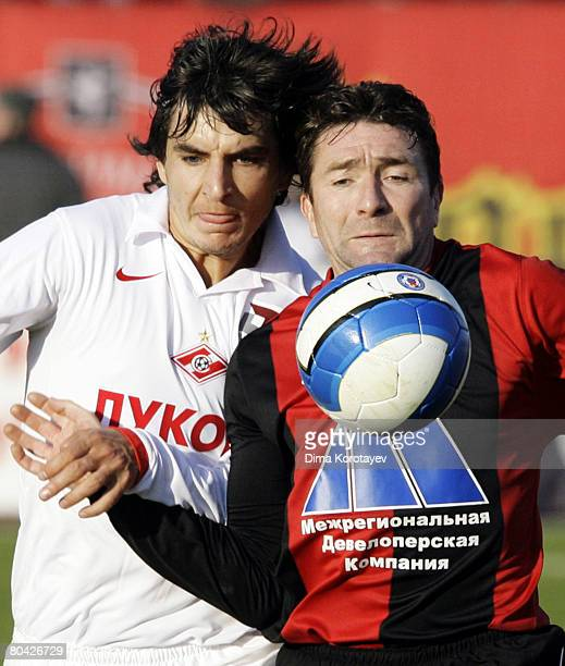 Yuri Drozdov of FC Khimki competes for the ball with Sergei Kovalchuk of FC Spartak Moscow during the Russian Football League Championship match...