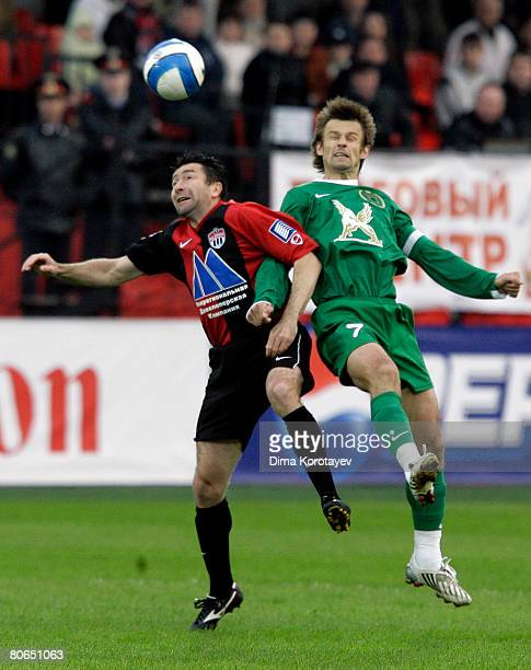 Yuri Drozdov of FC Khimki competes for the ball with Sergei Semak of FC Rubin Kazan during the Russian Football League Championship match between FC...