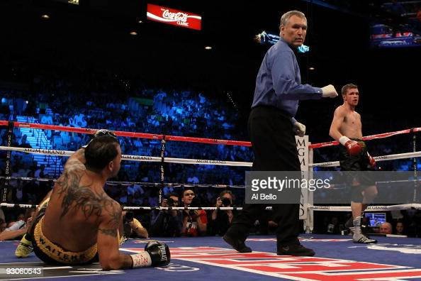Yuri Foreman knocks down Daniel Santos as referee Jay Nady looks over at Santos during their WBA super welterweight title fight at the MGM Grand...