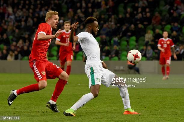 Yuri Gazinsky of Russia in action against Cheick Doukoure of Cote d'Ivoire's during the friendly football match at Krasnodar Stadium in Krasnodar...