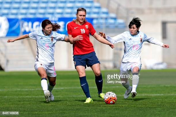 Yuri Kawamura and Mayu Sasaki of Japan challenges Ingvild Isaksen of Norway during the match between Norway v Japan Women's Algarve Cup on March 6...