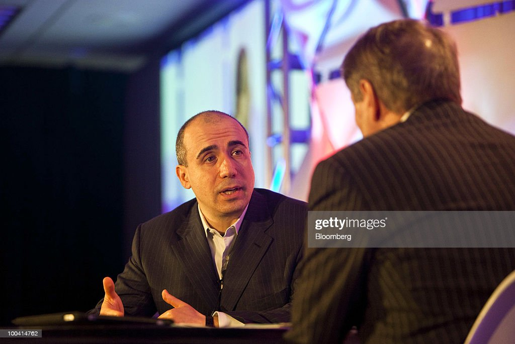 Yuri Milner, chief executive officer of Digital Sky Technologies, speaks during the TechCrunch Disrupt conference in New York, U.S., on Monday, May 24, 2010. Milner discussed his company's investment strategy in social-networking companies like Facebook Inc. Photographer: Ramin Talaie/Bloomberg via Getty Images