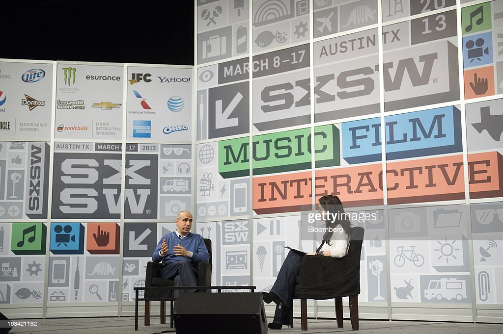 Yuri Milner, co-founder of Mail.ru Group Ltd., left, speaks during an interview at the South by Southwest Interactive Festival (SXSW) in Austin Texas, U.S., on Saturday, March 9, 2013. The Russian investor, whose early bet on Facebook Inc. made him a billionaire, sees the social-network as one of the three websites that will endure for 100 years. Photographer: David Paul Morris/Bloomberg via Getty Images