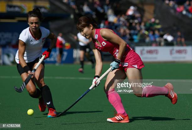 Yuri Nagai of Japan and Marlena Rybacha of Poland battle for possession during day 4 of the FIH Hockey World League Semi Finals Pool B match between...