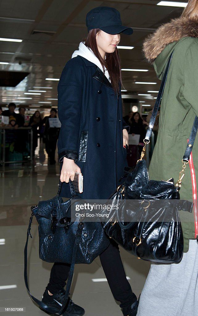 Yu-Ri of Girls' Generation is seen at Gimpo International Airport on February 11, 2013 in Seoul, South Korea.