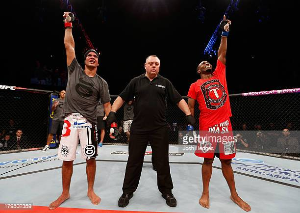 Yuri Villefort and Sean Spencer reacts as the judges' scores are read after their welterweight fight during the UFC on FOX Sports 1 event at...