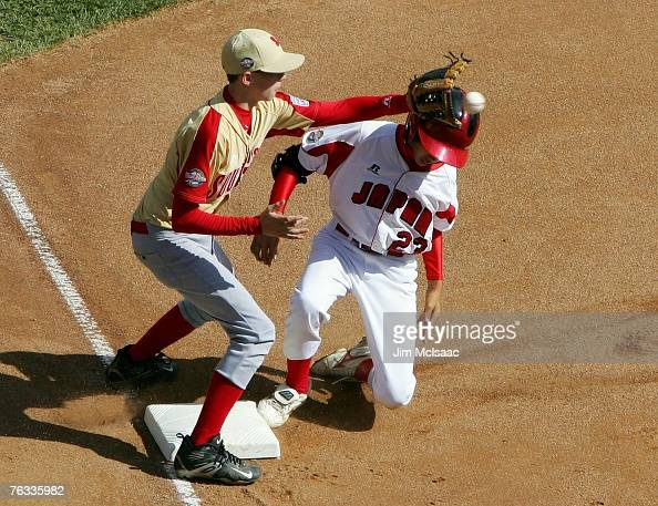 Yuri Yasuda of the Japanese team from Tokyo Japan is safe at third with an RBI triple ahead of the throw to Hunter Jackson of the Southeast team from...
