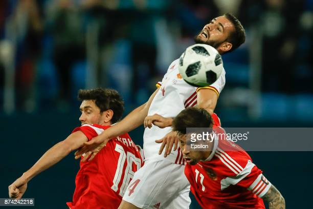 Yuri Zhirkov and Fedor Smolov of Russia vie for the ball with Nacho of Spain during Russia and Spain International friendly match on November 14 2017...