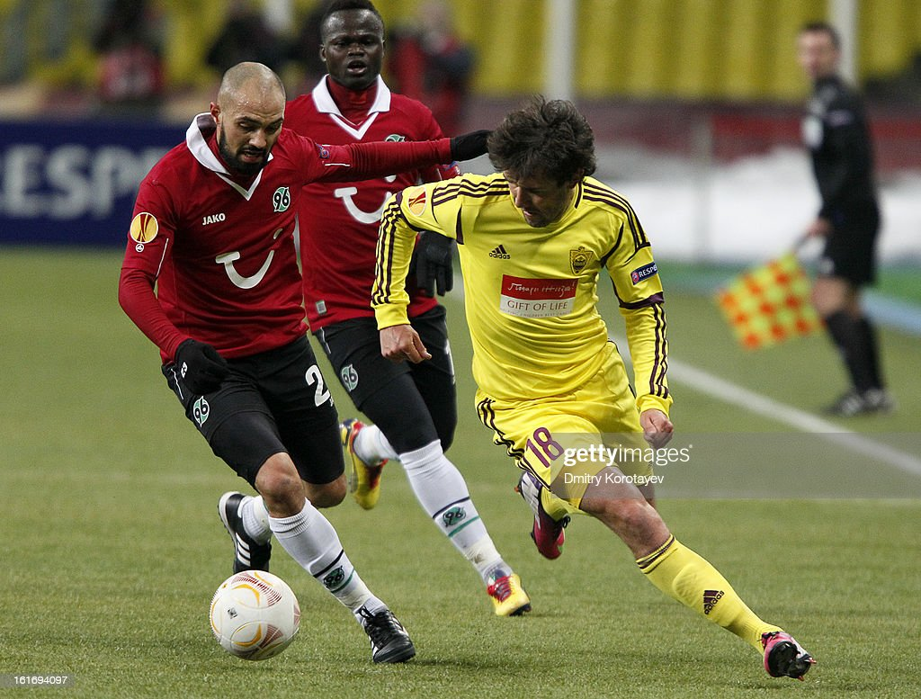 Yuri Zhirkov of FC Anji Makhachkala is challenged by Sofian Chahed of Hannover 96 during the UEFA Europa League round of 32 first leg between FC Anji Makhachkala and Hannover 96 at the Luzhniki Stadium on February 14, 2013 in Moscow, Russia.
