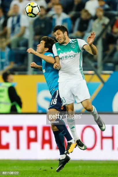 Yuri Zhirkov of FC Zenit Saint Petersburg and Apti Akhyadov of FC Akhmat Grozny vie for a header during the Russian Football League match between FC...