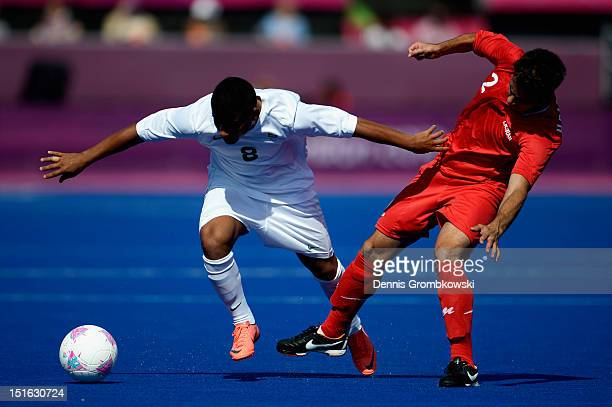 Yurig Gregory Dos Santos Ribeiro of Brazil and Hashem Rastegarimobin of the Islamic Republic of Iran battle for the ball during the Men's Team...