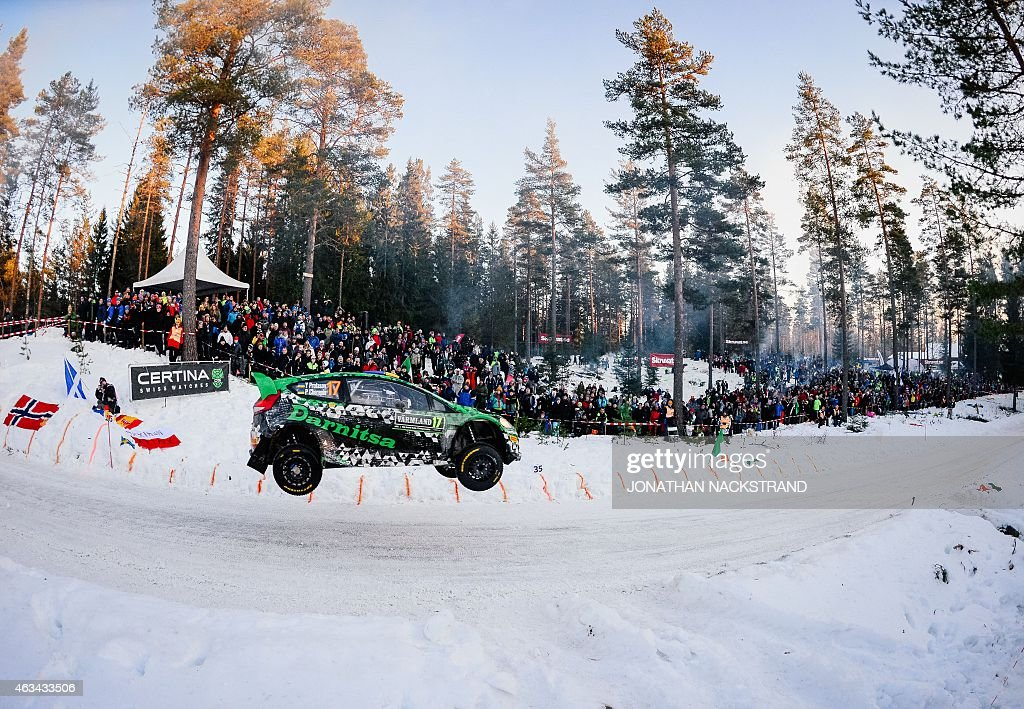 Yurii Protasov of Ukraine and his codriver Pavlo Cherepin steer their Ford Fiesta WRC during the 18th stage of the Rally Sweden second round of the...