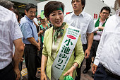 Yuriko Koike a Liberal Democratic Party lawmaker and former defense minister greets people before she deliver her speech campaign for the July 31...
