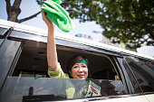 Yuriko Koike a Liberal Democratic Party lawmaker and former defense minister waves a green cloth given by her supporter after her speech campaign for...