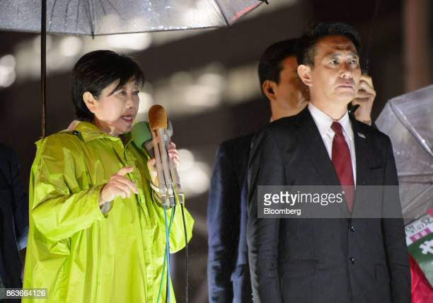 Yuriko Koike governor of Tokyo and leader of the Party of Hope left speaks as she stands next to Seiji Maehara leader of the Democratic Party during...