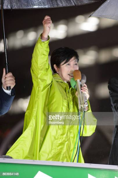 Yuriko Koike governor of Tokyo and leader of the Party of Hope left gestures while speaking during an election campaign rally in Tokyo Japan on...