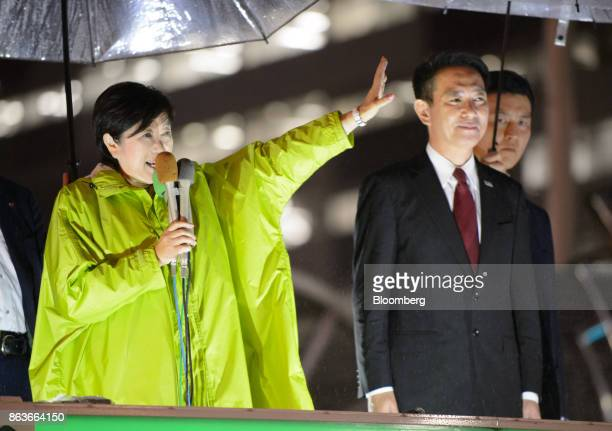 Yuriko Koike governor of Tokyo and leader of the Party of Hope left gestures while speaking as she stands next to Seiji Maehara leader of the...