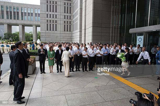 Yuriko Koike newly elected governor of Tokyo arrives and greet her coworkers during the first official day as a Tokyo Governor at Tokyo Metropolitan...