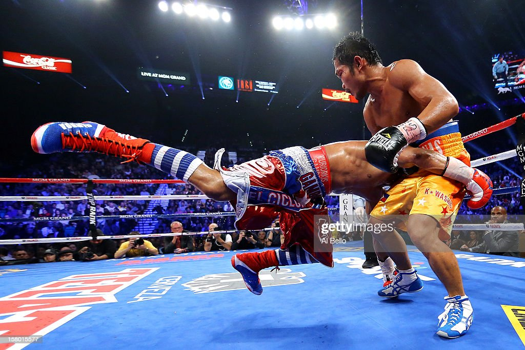 Yuriorkis Gamboa is picked up by Michael Farenas during their super featherweight bout at the MGM Grand Garden Arena on December 8, 2012 in Las Vegas, Nevada.