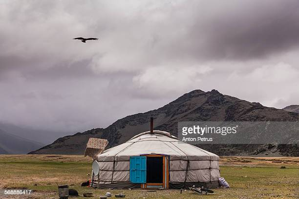 Yurt in the background of high mountains.