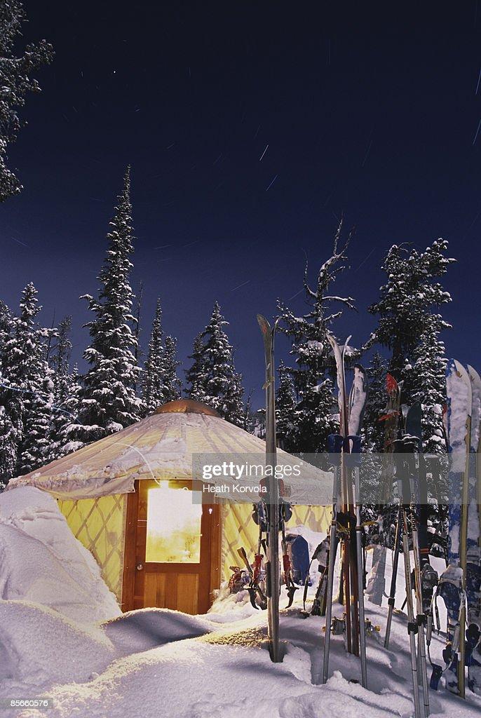 Yurt under stars in snow at night. : Stock Photo