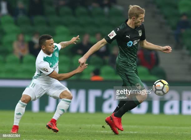 Yury Gazinsky of FC Krasnodar vies for the ball with Ismael of FC Akhmat Grozny during the Russian Premier League match between FC Krasnodar and FC...
