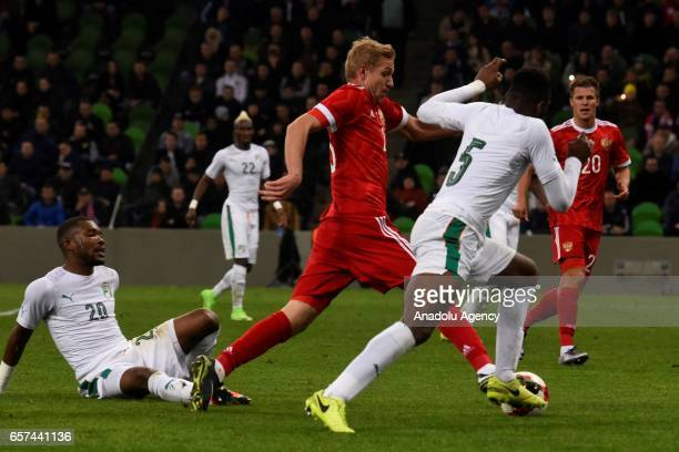 Yury Gazinsky of Russia in action against Die Serey and Wilfried Kanon of Cote d'Ivoire's during the friendly football match at Krasnodar Stadium in...