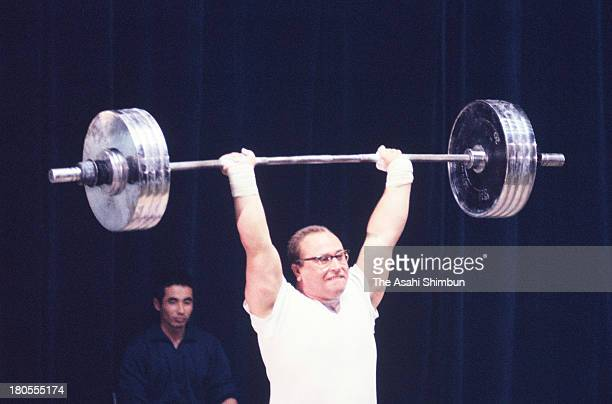 Yury Vlasov of Soviet Union competes in the Men's Weightlifting Heavyweight during the Tokyo Olympics at Shibuya Kokaido Hall on October 18 1964 in...