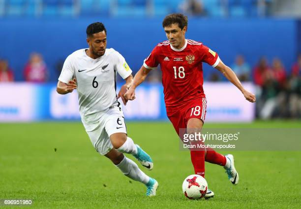 Yury Zhirkov of Russia attempts to get past Bill Tuiloma of New Zealand during the FIFA Confederations Cup Russia 2017 Group A match between Russia...