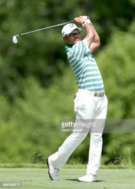 Yusaka Miyazato of Japan plays his tee shot on the par 3 16th hole during the first round of the 117th US Open Championship at Erin Hills on June 15...