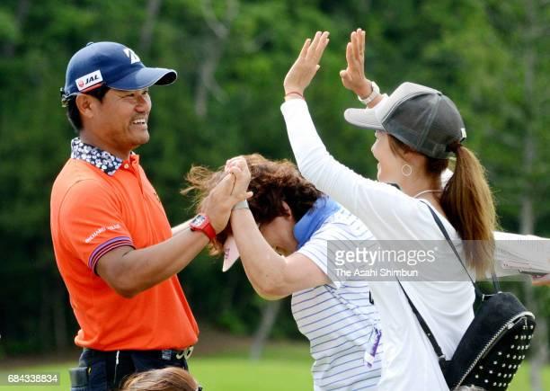 Yusaku Miyazato celebrates winning the Japan PGA Championship Nissin Cup Noodle Cup with his mother Toyoko and his sister and golfer Ai Miyazato at...