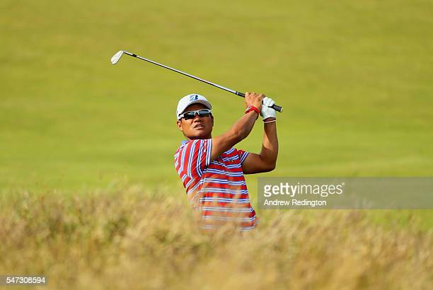 Yusaku Miyazato of Japan hits his second shot on the 12th during the first round on day one of the 145th Open Championship at Royal Troon on July 14...