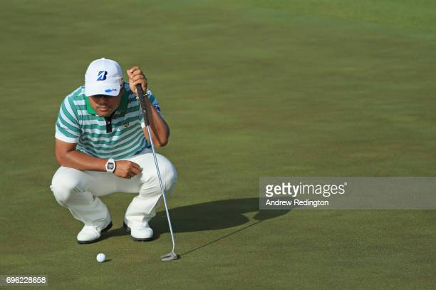 Yusaku Miyazato of Japan lines up a putt on the fourth green during the first round of the 2017 US Open at Erin Hills on June 15 2017 in Hartford...