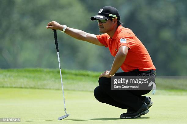 Yusaku Miyazato of Japan lines up a putt on the third hole during the final round of the US Open at Oakmont Country Club on June 19 2016 in Oakmont...