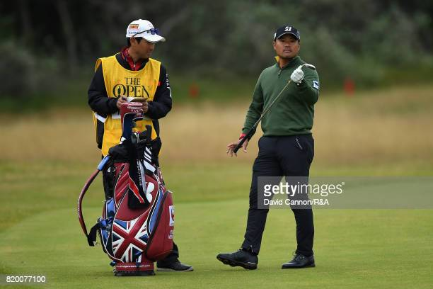 Yusaku Miyazato of Japan looks on with his caddie on the 1st hole during the second round of the 146th Open Championship at Royal Birkdale on July 21...