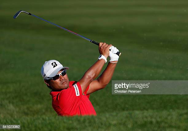 Yusaku Miyazato of Japan plays a shot on the tenth hole during the continuation of the second round of the US Open at Oakmont Country Club on June 18...
