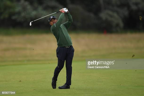 Yusaku Miyazato of Japan plays his second shot on the 1st hole during the second round of the 146th Open Championship at Royal Birkdale on July 21...
