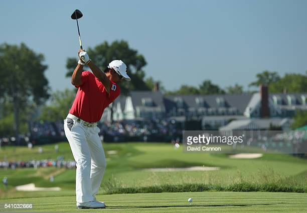 Yusaku Miyazato of Japan plays his shot from the 18th tee during the continuation of the second round of the US Open at Oakmont Country Club on June...