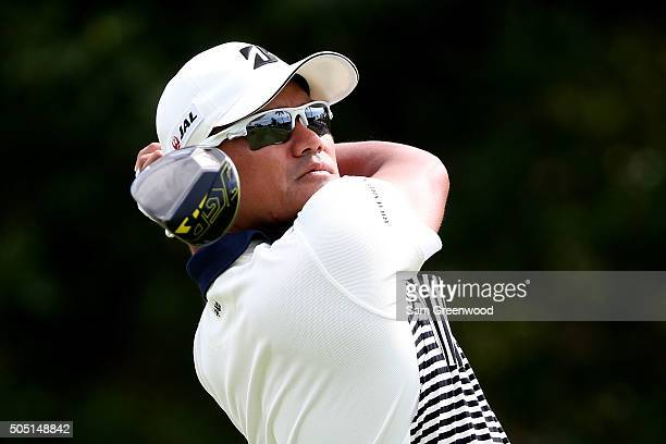 Yusaku Miyazato of Japan plays his shot from the first tee during the second round of the Sony Open In Hawaii at Waialae Country Club on January 15...