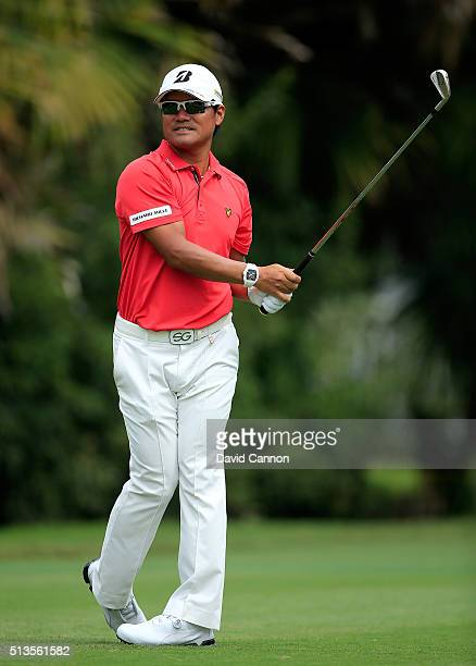 Yusaku Miyazato of Japan plays his tee shot at the par 3 13th hole during the first round of the 2016 World Golf Championship Cadillac Championship...