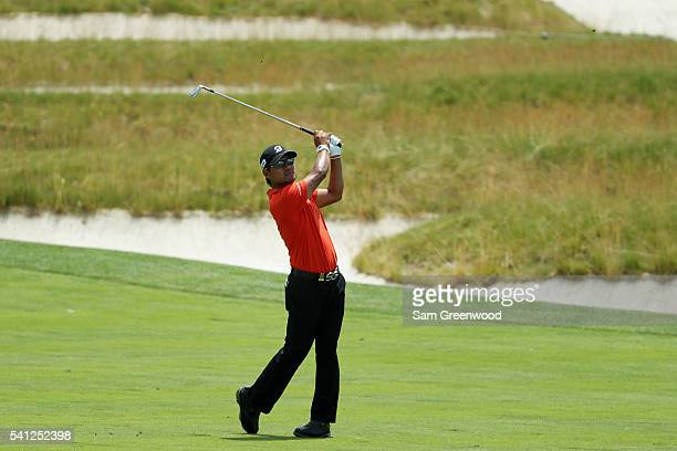 Yusaku Miyazato of Japan takes his shot on the third hole during the final round of the US Open at Oakmont Country Club on June 19 2016 in Oakmont...